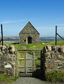 St. Oran's Chapel, alongside the Abbey Church, Iona. Inner Hebrides, Scotland Allan Coutts/ Scottish Viewpoint uk,u.k,Great Britain,GB,G.B,Scotland,Scottish,nobody,daytime,abbey,arch,architectural,architecture,building,carved,chapel,chiseled,christian,church,coast,coastal,decorated,door,doorway,ecclesiastical,