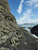 Basalt columns next to Fingal's Cave on the Isle of Staffa. Hand rail goes from boat landing to cave to assist tourists.Scotland Allan Coutts/ Scottish Viewpoint uk,u.k,Great Britain,GB,G.B,Scotland,Scottish,nobody,daytime,argyll,basalt,bute,causeway,cave,caves,cliffs,columns,entirely,features,fingal,found,geological,geology,giants,hebrides,island,islands,mull