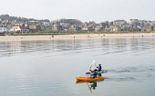 Couple in canoes off beach at North Berwick in East Lothian, Scotland, United Kingdom Iain Masterton/ Scottish Viewpoint North Berwick,town,beach,canoes,canoeing,recreation,leisure,activity,activities,watersports,East Lothian,Scotland,Scottish,daytime,outdoors,view,UK,United Kingdom,Britain,British