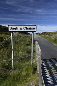 cheese bay,road sign, north uist, Outer Hebrides, Scotland Mark Hicken/ Scottish Viewpoint uk,u.k,Great Britain,GB,G.B,Scotland,Scottish,nobody,daytime,bagh a chaise,cheese bay,road,sign,north uist,outer hebrides,gaelic