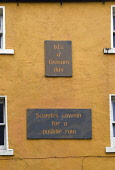 Scots language plaques on the front of a building, Thurso, Caithness, Highlands of Scotland Mark Hicken/ Scottish Viewpoint uk,u.k,Great Britain,GB,G.B,Scotland,Scottish,nobody,daytime,outdoors,scots language,sayings,plaques,language,thurso,caithness