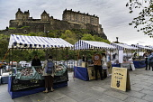 View of Weekend Farmers Market at foot of Edinburgh Castle in Scotland , United Kingdom. Iain Masterton/ Scottish Viewpoint Edinburgh,farmers market,Weekend,Edinburgh Castle,markets,Edinburgh Market,organic,stalls,Scotland,Scottish,outdoor,daytime,travel,tourism,fresh produce,local,United Kingdom,Europe,European,UK,britain