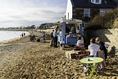 View of beach with mobile coffee shop at Elie in the East Neuk of Fife in Scotland, United Kingdom Iain Masterton/ Scottish Viewpoint Elie,beach,East Neuk Fife,Fife,beaches,coastal,village,Scotland,Scottish,scottish beach,villages,travel,tourism,United Kingdom,daytime,leisure,coastal route,seaside,people