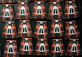 Geometric view of fridge magnets in shape of Scottish kilts for sale in tourist gift shop on the Royal Mile in Edinburgh, Scotland, United Kingdom Iain Masterton/ Scottish Viewpoint Edinburgh,Scotland,Scottish,fridge magnets,fridge magnet,kilt,kilts,tourist shop,souvenir,souvenirs,gift shop,shopping,tourists,tourism,travel,UK,Europe,European,detail,rows