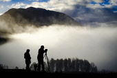 Photographers taking pictures at the Glen Orchy viewpoint on a misty, cloudy autumn morning, Highlands of Scotland Andrew Wilson/ Scottish Viewpoint uk,u.k,Great Britain,GB,G.B,Scotland,Scottish,2 people,daytime,outdoors,Glen Orchy,Pictures,Silhouette,Tourists,highlands,low cloud,misty,photographers,snappers,snaps