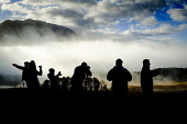 Photographers taking pictures at the Glen Orchy viewpoint on a misty, cloudy autumn morning, Highlands of Scotland Andrew Wilson/ Scottish Viewpoint uk,u.k,Great Britain,GB,G.B,Scotland,Scottish,group,daytime,outdoors,Glen Orchy,Pictures,Silhouette,Tourists,highlands,low cloud,misty,photographers,snappers,snaps