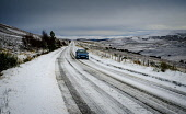 A car makes its way carefully along the A939 near Tomintoul, Highlands of Scotland.  At 1400 feet above sea level it is one of the highest roads in Scotland. Andrew Wilson/ Scottish Viewpoint uk,u.k,Great Britain,GB,G.B,Scotland,Scottish,nobody,daytime,outdoors,A939,Old Military Road,Tomintoul,Winter Scene,landscape,snow plow,snowing,winter,road