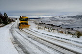 Winter comes to the Scottish Highlands - A snow plow clears the A939 Old Military Road near Tomintoul. At 1400 feet above sea level it is one of the highest roads in Scotland. Andrew Wilson/ Scottish Viewpoint uk,u.k,Great Britain,GB,G.B,Scotland,Scottish,nobody,daytime,outdoors,A939,Old Military Road,Tomintoul,Winter Scene,landscape,snow plow,snowing,winter,road,plough