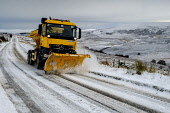 Winter comes to the Scottish Highlands - A snow plow clears the A939 Old Military Road near Tomintoul. At 1400 feet above sea level it is one of the highest roads in Scotland. Andrew Wilson/ Scottish Viewpoint A939,Old Military Road,Tomintoul,Winter Scene,landscape,snow plow,snowing,winter,road,plough