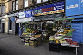 Green Grocers shop selling fruit and vegetables on Victoria Road in Govanhill district of Glasgow, Scotland, United Kingdom Iain Masterton/ Scottish Viewpoint Govanhill,Glasgow,Scotland,Scottish,district,shop,shops,shopping,greengrocers,grocery store,neighbourhood,inner city,cities,urban,building exterior,United Kingdom,UK,Britain,British,Europe,European,po