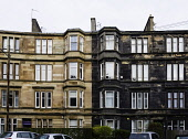 View of typical  sandstone tenement apartment buildings , one after cleaning and the other without cleaning still showing black sooty discolouration in Govanhill district of Glasgow, Scotland, United... Iain Masterton/ Scottish Viewpoint Govanhill,Glasgow,Scotland,Scottish,district,neighbourhood,housing,houses,home,homes,property,residential,inner city,cities,urban,dwelling,dwellings,property market,building exterior,apartment block,s