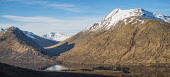 """Loch Cluanie and Cluanie Lodge, from the south.  The hills are Ciste Dhubh (979m) and a'Chralaig (1120m), Scotland Alan Gordon/ Scottish Viewpoint Ciste Dhubh,Cluanie,Glen Moriston,Highlands,Kintail,Munro,SSSI,Scotland,Special Protection Area,a""""Chralaig,atmospheric,dramatic,hills,hydro-electric,lake,landscape,loch,mountains,nature conservation,n"""