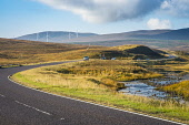 The A835 Garve to Ullapool trunk road east of the Aultguish Inn, with part of the Lochluichart wind farm, Scotland Alan Gordon/ Scottish Viewpoint Highlands,Munro,Ross and Cromarty,Scotland,autumn,bend,car,colour,curve,energy,engineering,glen,highway,hills,landscape,morning,mountains,nobody,power,river,road,sunlight,sunny,traffic,transport,turbi