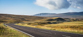The A835 Garve to Ullapool trunk road east of the Aultguish Inn, with part of the Lochluichart wind farm, Scotland Alan Gordon/ Scottish Viewpoint Highlands,Munro,Ross and Cromarty,Scotland,autumn,bend,colour,curve,energy,engineering,glen,highway,hills,landscape,morning,mountains,nobody,panoramic,power,river,road,sunlight,sunny,traffic,transport