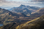 The hills of Glenelg, with Beinn Sgritheall and the distant Skye Cuillin, from Sgurr a'Mhaoraich Beag,Scotland Alan Gordon/ Scottish Viewpoint Beinn Sgritheall,Corbetts,Glenelg,Munro,National Scenic Area,Scotland,atmospheric,autumn,colour,dramatic,hills,landscape,mountains,nobody,peaks,remote,sunlight,sunny,wild,wilderness