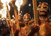 Edinburgh, Scotland,United Kingdom. 30 December, 2017. Members of legendary Up Helly Aa Vikings from Shetland, in full costume and with flaming torches before Torchlight Procession which forms one par... Iain Masterton/Scottish Viewpoint Edinburgh,Scotland,Scottish,Torchlight procession,new Yesr,Night,UK,celebrations,parade,traditional,winter,Hogmanay,Edinburgh Hogmanay,2017