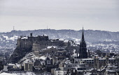 Snow falls on city of Edinburgh in December. Skyline view of city towards the Edinburgh castle from Salisbury Crags ,Scotland, UK. Iain Masterton/Scottish Viewpoint Edinburgh,Edinburgh skyline,Edinburgh cityscape,Edinburgh castle,skyline Edinburgh,Cityscape Edinburgh,winter,snow,weather,snow fall,snowing,snowy,cold,wintry,cold weather,Scotland,Scottish,city,citie
