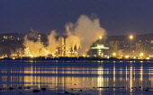 Grangemouth, Scotland, United Kingdom. 12 December, 2017. Night view of Grangemouth refinery in Scotland operated by INEOS. The global price of Brent crude increased today because of repairs to the Fo... Iain Masterton/Scottish Viewpoint Grangemouth,Grangemouth refinery,oil pipeline,INEOS,Scotland,Scottish,Brent crude,industry,refineries,UK,United Kingdom,Britain,british,energy,energy price,energy prices,night,general view,2017