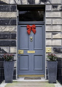 Christmas decorations of front doors of Georgian Houses in the New Town of Edinburgh , Scotland, United Kingdom Iain Masterton/Scottish Viewpoint Christmas decoations,Edinburgh New Town,front door wreath,house decoration,scotish culture,property,decorated,doors,entrance,detail,doorway,doorways,properties,housing,Scotland,Scottish,building exter