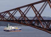 An LNG ship operated by INEOS leaves Grangemouth refinery on the River Forth and passes below the famous Forth Bridge. The ship is designed to transport shale gas from the USA to Grangemouth in Scotla... Iain Masterton/Scottish Viewpoint INEOS,shale gas,tanker,lng,Scotland,Scottish,shipping,imported,energy,Grangemouth,United Kingdom,fracking,fracked,liquified natural gas,Lng ship,lng tanker,2017