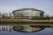 View of SSE Hydro arena beside River Clyde in Glasgow , United Kingdom Iain Masterton/Scottish Viewpoint SSE Hydro,Glasgow Hydro,stadium,Glasgow,River Clyde,Scotland,Scottish,reflection,reflected daytime,blue sky,reflections,modern architecture,Glasgow Armadillo,Armadillo Glasgow,property development,gen