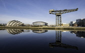 View of Finnieston Crane, SEC Armadillo and SSE Hydro arena beside River Clyde on blue sky winter day, Scotland, United Kingdom Iain Masterton/Scottish Viewpoint SEC Armadillo,SSE Hydro,Glasgow,River Clyde,riverside,Scotland,Scottish,city,Glasgow Finnieston Crane,cities,view,daytime,blue sky,reflection,reflections,Finnieston Crane,urban,regeneration,gentrifica