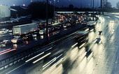Night view of traffic on M8 Motorway during bad weather in central Glasgow, Scotland, United Kingdom. Iain Masterton/Scottish Viewpoint Motorway traffic,traffic on motorway,highway,traffic on busy highway,glasgow,M8 Motorway,night,transport,transportation,highways,road,roads,infrastructure,UK,United Kingdom,Britain,british,Europe,Euro