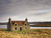 Derelict croft house on the Isle of Lewis,  Outer Hebrides,Scotland Allan Coutts/Scottish Viewpoint uk,u.k,Great Britain,GB,G.B,Scotland,Scottish,nobody,daytime,outdoors,abandoned,cottage,croft,derelict,crumbling,deserted,dilapidated,dwelling,empty,home,house,loch,old,roof,ruin,neglegted,rusty,rural
