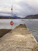 Looking out to Loch Broom from jetty at Ullapool,Highlands of Scotland Allan Coutts/Scottish Viewpoint u.k,Great Britain,GB,G.B,Scotland,Scottish,nobody,daytime,outdoors,harbour,loch,loch broom,evening,ocean,orange,jetty