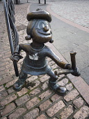 Bronze statue of t Minnie The Minx with a catapult from the children's comic The Beano in City Square, Dundee, Scotland Allan Coutts/Scottish Viewpoint u.k,Great Britain,GB,G.B,Scotland,Scottish,nobody,daytime,outdoors,book,bronze,comic,cartoon,dan,dandy,desperate,statue,tayside,high street,d c thomson,discovery,minnie,minx,dawg,street,angus,hero