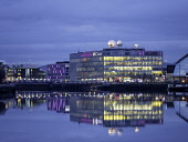 Evening view of BBC Scotland headquarters reflected in River Clyde in Glasgow , Scotland, United Kingdom Iain Masterton/Scottish Viewpoint BBC Scotland,Glasgow,office,headquarters,studio,studios,BBC Scotland studios Glasgow,BBC Scotland studios,Scotland,broadcaster,media,building exterior,twilight,dusk,evening,River Clyde,office building