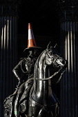 Statue of Wellington on horseback with traffic cone on his head at Gallery of Modern Art in Exchange Square, Glasgow, United Kingdom Iain Masterton/Scottish Viewpoint Glasgow,Wellington ststue,traffic cone,wellington traffic cone,wellington statue traffic cone on head,Exchange square,Scotland,Scottish,humour,landmark,Gallery of Modern art,statues,city,cities,city c