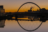 Glasgow Arc bridge(Squiggly Bridge) over the River Clyde at Sunrise Glasgow Scotland D.G.Farquhar/Scottish Viewpoint uk,u.k,Great Britain,GB,G.B,Scotland,Scottish,nobody,nightime,outdoors,City of Glasgow,Glasgow,Glasgow Arc Bridge,Reflections,River Clyde,Squiggly Bridge,Squinty Bridge,Sunrise,road bridge