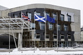 Flags flying outside Scottish Parliament building at Holyrood in Edinburgh, Scotland, United Kingdom Iain Masterton/Scottish Viewpoint Holyrood,Scottish Parliament,Scotland,Scottish,Scottish government,scotland parliament,government,flags,flying,outdoors,nobody,daytime,in front,building exterior,scottish parliament building flags,uni