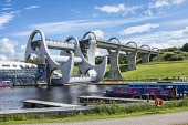 Falkirk Wheel, Falkirk, Forth & Clyde Canal meets Union Canal , Scotland Jim Steele/Scottish Viewpoint uk,u.k,Great Britain,GB,G.B,Scotland,Scottish,group,daytime,outdoors,Falkirk Wheel,silhouette,boat lift,canal,sky,blue sky,engineering,Falkirk,summer,boat,barge