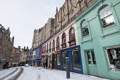 View of colourful shop fronts on historic Victoria Street in Edinburgh Old Town after heavy snow, Scotland, United Kingdom Iain Masterton/Scottish Viewpoint Victoria Street Edinburgh,Edinburgh Victoria Street,Edinburgh,snow,winter,wintry,historic Old Town Edinburgh,Edinburgh Old Town,cold,historic,streets,travel,tourism,west bow,UK,United Kingdom,city,cit