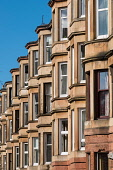 View of row of traditional sandstone tenement apartment buildings in Glasgow West End, Scotland, united kingdom Iain Masterton/Scottish Viewpoint Glasgow,Glasgow housing,tenements,tenement flats,homes,apartment building,row,tewrrace,terraced,residential,west end Glasgow,Glasgow west end,Scotland,Scottish,houses,UK,united Kingdom,British,city,ur