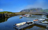 The tiny harbour on Easdale Island with Seil Island shrouded in low cloud in the background.  Easdale Island, the smallest permanently-inhabited island of the Inner Hebrides, Scotland Andrew Wilson /Scottish Viewpoint uk,u.k,Great Britain,GB,G.B,Scotland,Scottish,nobody,daytime,outdoors,Easdale Island,Inner Hebrides,Scottish Highlands,remote,small,tiny,car free,still pools,slate quarries,Argyll