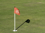 Detail of flag in hole of putting green at Gullane Golf Course in East Lothian , Scotland, United Kingdom Iain Masterton /Scottish Viewpoint Gullane Golf Course,Gullane,Gullane Golf Club,Golf scotland,flag,putting green,East Lothian,Scotland,Scottish,detail,nobody,sport,UK,united Kingdom,Britain,British