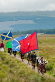 The Loyal Men of Lochaber annual march to Highbridge near Spean Bridge,where the first shot of the 1745 Jacobite uprising was fired., Highlands of Scotland Kenny Ferguson/ Scottish Viewpoint uk,u.k,Great Britain,GB,G.B,Scotland,Scottish,group,daytime,outdoors,Lochaber,flags,banners,tradition,tradional,tartan