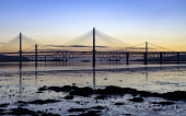 Sunrise view of the three major bridges crossing the Firth of Forth at South Queensferry; Queensferry Crossing, North Road Bridge and the Forth Bridge ( rail) , Scotland, United Kingdom. Iain Masterton /Scottish Viewpoint Forth bridges,Scotland,Scottish,Firth of Forth,Queensferry Crossing,Forth Road Bridge,Forth Bridge,sunrise,dawn,early morning,transport,transportation,infrastructure,crossings,engineering,built struct