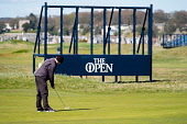 Golfer putting on green in front of scoreboard under construction at Carnoustie Golf Links in Carnoustie, Angus, Scotland, UK. Carnoustie is venue for the 147th Open Championship in 2018. Iain Masterton /Scottish Viewpoint Carnoustie,Carnoustie Golf Links,Carnoustie Golf Course Scotland,Carnoustie Golf course  travel,tourism,Angus,Scotland,Scottish,UK,united Kingdom,resort,preparations,preparation,construction,147th Ope