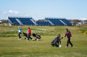 Golfers on fairway with spectator stands under construction to rear at Carnoustie Golf Links in Carnoustie, Angus, Scotland, UK. Carnoustie is venue for the 147th Open Championship in 2018. Iain Masterton /Scottish Viewpoint Carnoustie,Carnoustie Golf Links,Carnoustie Golf Course Scotland,Carnoustie Golf course  travel,tourism,Angus,Scotland,Scottish,UK,united Kingdom,resort,preparations,preparation,construction,147th Ope