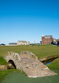 View of 18th hole fairway of  The Royal and Ancient Golf Club (R&A) and famous old Swilken Bridge over Swilken Burn on 18th Hole atOld Course in St Andrews, Fife, Scotland, UK. Iain Masterton /Scottish Viewpoint The Royal and Ancient Golf Club,R&A St Andrews,St Andrews Swilken Bridge,Swilken Burn,club house,Old Course Swilken Bridge,Old COurse Swilken Burn,clubhouse,St Andrews,St Andrews Scotland,St Andrews G