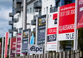 Many sign boards from estate agents for properties for sale and rent outside large modern apartment blocks at western Harbour in Leith, Edinburgh, Scotland, UK Iain Masterton /Scottish Viewpoint estate agents,housing,homes,for rent,for sale,signs,many,apartments,apartment block,property,real estate,sign,rental,Edinburgh,Leith,Scotland,Scottish,UK,United Kingdom,UK housing market,uk property m