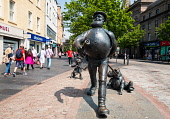 Statue of Desperate Dan on the High Street in central Dundee, Scotland, UK Iain Masterton /Scottish Viewpoint Desperate Dan Dundee,Dundee,Desperate Dan statue,high street,Scotland,Scottish,UK,United Kingdom,sculpture,popular culture,people