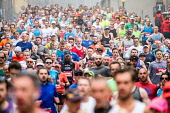 Runners make their way down the Royal Mile towards the Scottish Parliament Building at Holyrood during the Edinburgh Marathon 2018 Iain Masterton /Scottish Viewpoint Edinburgh Marathon 2018,Edinburgh,runners,Scotland,Scottish,running,marathon,EMF,Edinburgh Marathoin Festival