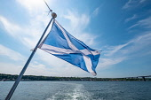 Scottish saltire flag flying from rear of ship on Firth of Forth river in Scotland, UK, United Kingdom Iain Masterton /Scottish Viewpoint Scottish flag,saltire flag,scottish saltire flag,flying,firth of forth,scotland,flags,st andrews cross,nobody