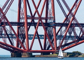 Sailing boat beside Forth Bridge (Forth Railway Bridge) crossing the Firth of Forth between North and South Queensferry,UK Iain Masterton /Scottish Viewpoint Forth Bridge,Scotland,Forth Bridge Scotland,railway bridge,bridges,historic,Scottish,infrastructure,transport,transportation,UK,United Kingdom,daytime,engineering