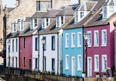 View of row of colourful terraced houses in South Queensferry in West Lothian, Scotland, UK, United Kingdom Iain Masterton /Scottish Viewpoint South Queensferry,Scotland,Scottish town,town,houses,terraced houses,housing,colorful,coloured,colourful,row,homes,South Queensferry Scotland,street,UK,united Kingdom,Britain,building exterior,people